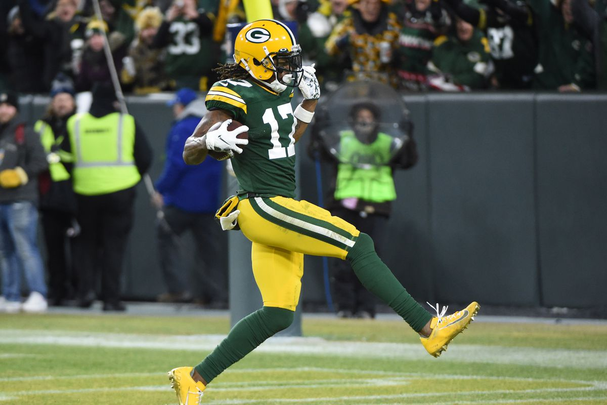 Green Bay Packers wide receiver Davante Adams scores a touchdown against the Seattle Seahawks in the third quarter of a NFC Divisional Round playoff football game at Lambeau Field