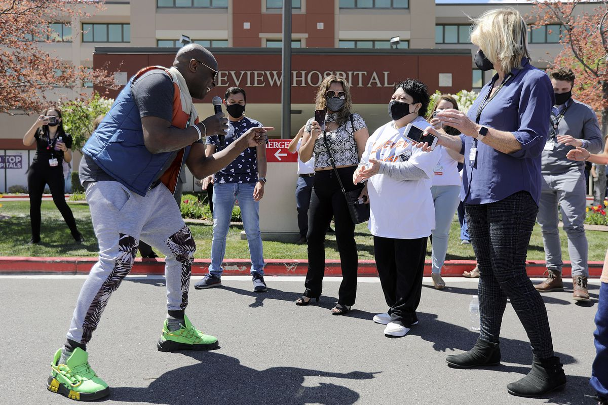 Alex Boyé sings to Ana Lucio, who was fighting COVID-19 on a ventilator this time last year, during a concert outside of Lakeview Hospital in Bountiful on Tuesday, May 4, 2021. Lucio was in the hospital for more than two months and was Lakeview's longest COVID-19 admission. She was discharged in May 2020.
