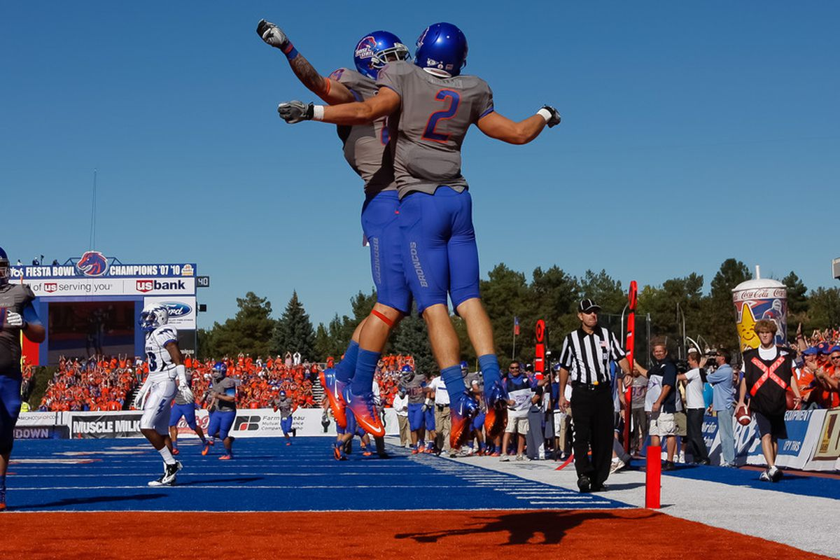 BOISE, ID - OCTOBER 22: Tyler Shoemaker #89 and Matt Miller #2 of the Boise State Broncos celebrate a touchdown against the Air Force Falcons at Bronco Stadium on October 22, 2011 in Boise, Idaho.  (Photo by Otto Kitsinger III/Getty Images)