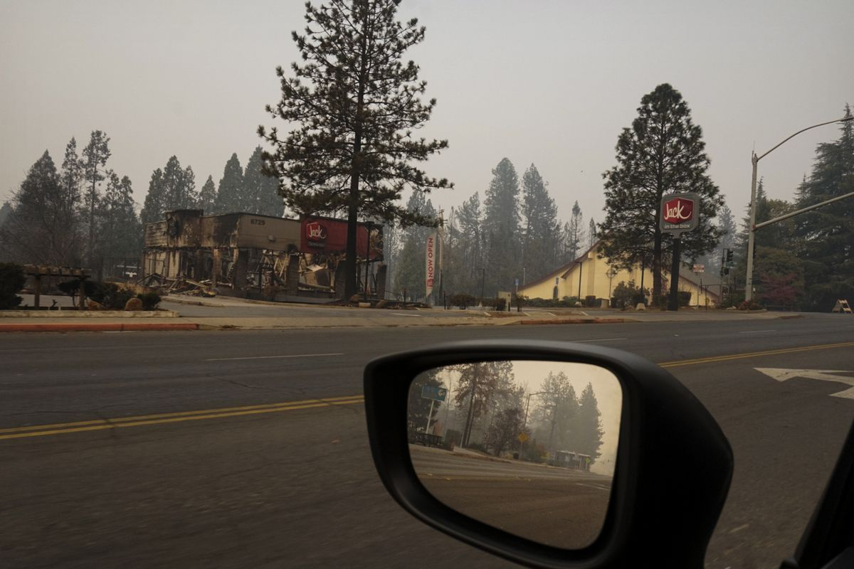 Only the frames of restaurants and stores remain standing after the Camp Fire tore through Paradise, California.
