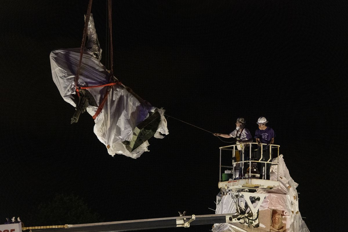City crews removed the Christopher Columbus statue from its pedestal in Grant Park in July 2020.