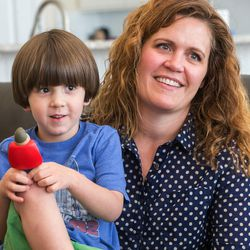 Heidi Wallis talks while holding her youngest son, Louie, during an interview in their Bluffdale home on Wednesday, Nov. 2, 2016. Louie and his sister share a rare disease — guanidinoacetate methyltransferase (GAMT) deficiency. Heidi Wallis and her husband, Trey, are fighting to have GAMT screening placed on the national newborn screening list.
