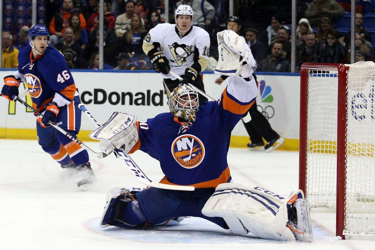 Kevin Poulin, Islanders avoid arbitration, settle for guaranteed ...