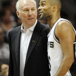 San Antonio Spurs head coach Gregg Popovich, left, talks to Spurs' Tony Parker, of France, during the first half of an NBA basketball game against the Utah Jazz, Sunday, April 8, 2012, in San Antonio.