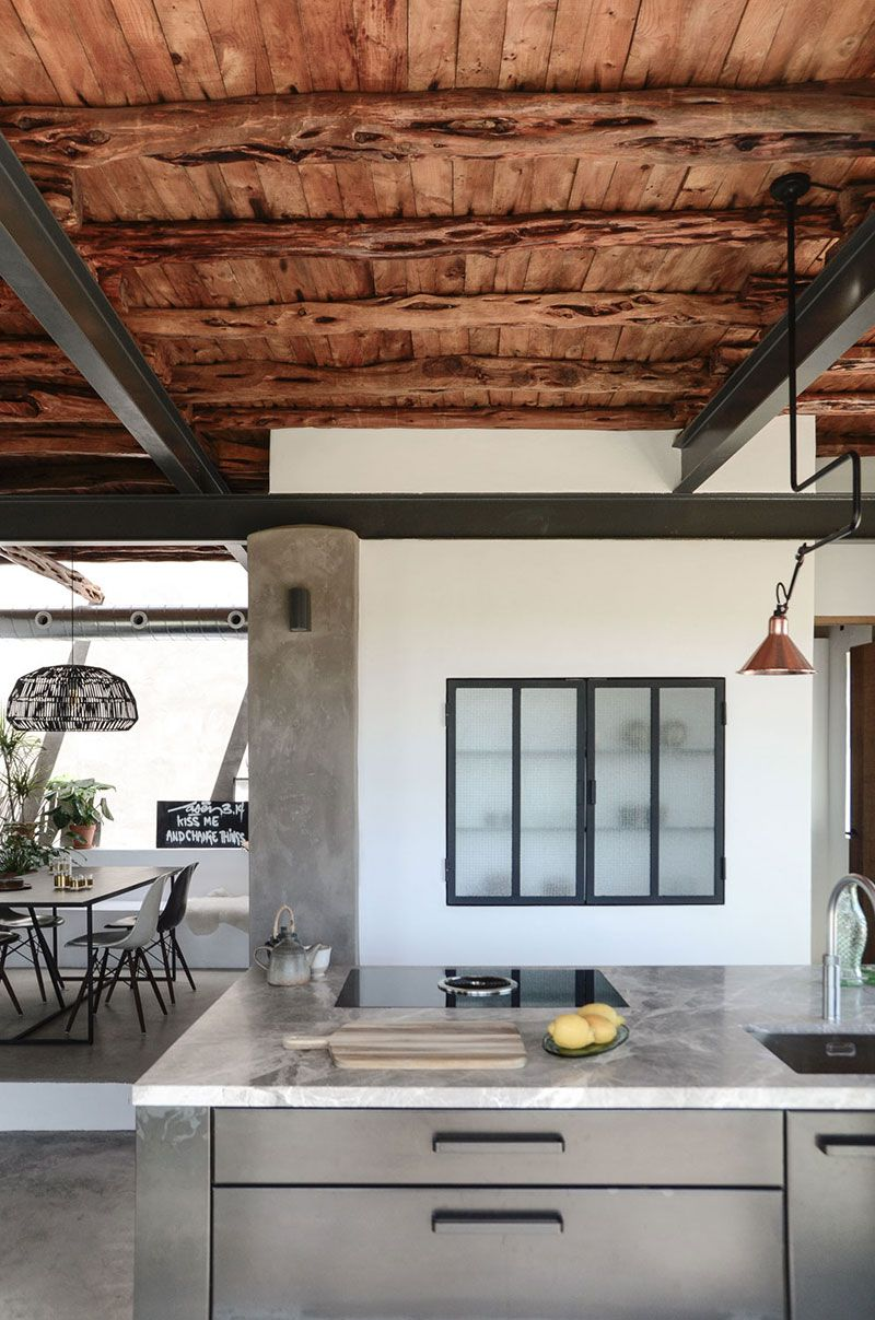 Concrete floors and island in kitchen