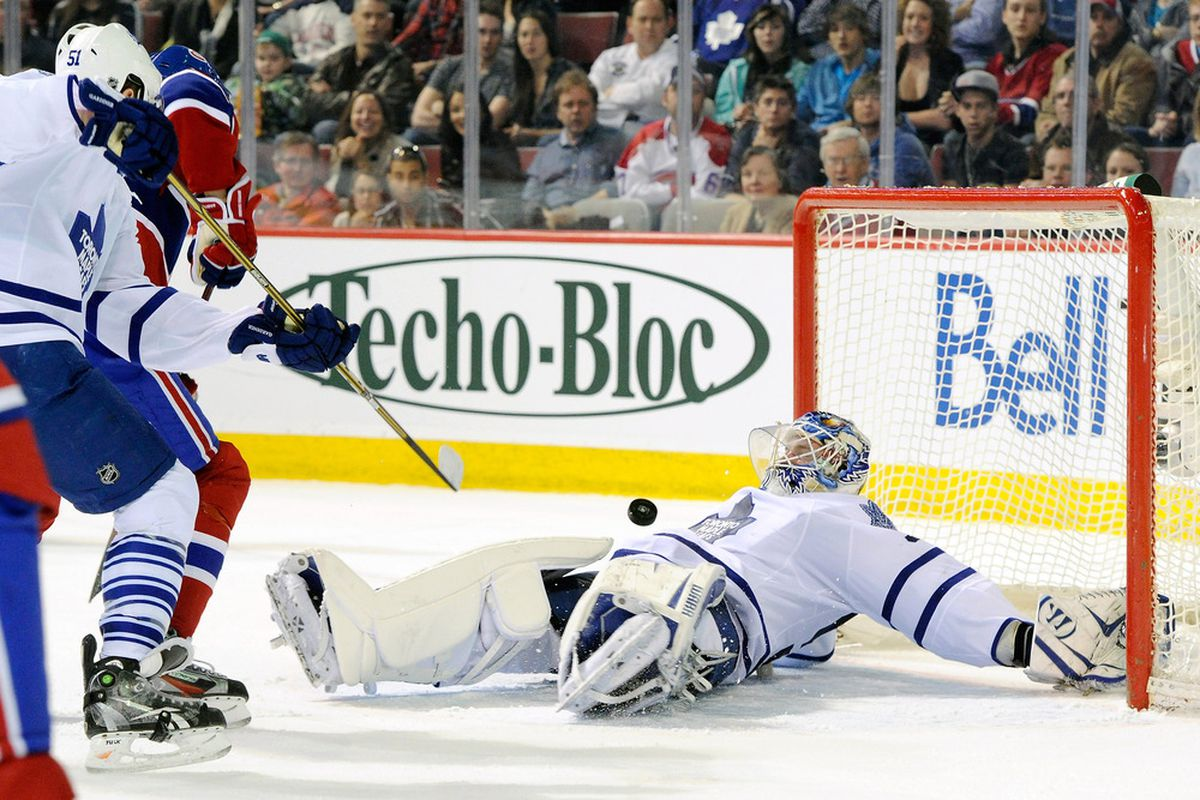 MONTREAL, CANADA - MARCH 3:  Jonas Gustavsson of the Toronto Maple Leafs stops the puck against the Montreal Canadiens at the Bell Centre on Saturday. (Photo by Richard Wolowicz/Getty Images)