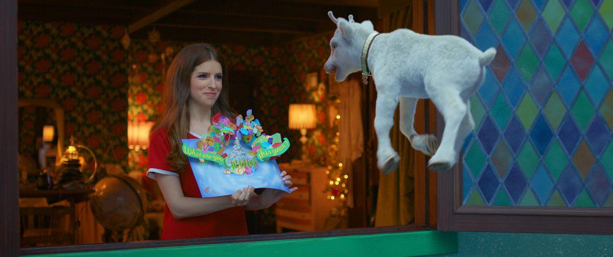 Noelle (Anna Kendrick) holds a pop up card to her flying reindeer calf, Snowcone, in Noelle