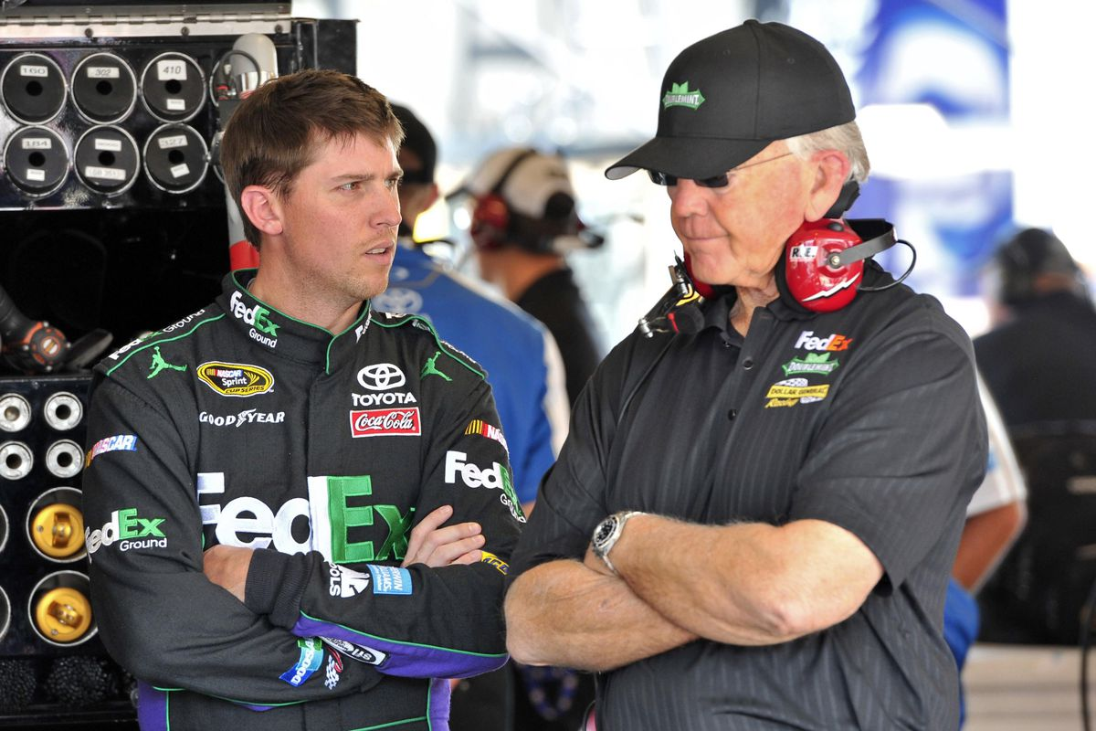 Sep 14, 2012; Joliet, IL, USA; NASCAR Sprint Cup Series driver Denny Hamlin (left) talks with owner Joe Gibbs (right) during practice for the Geico 400 at Chicagoland Speedway.  Mandatory Credit: Rob Grabowski-US PRESSWIRE
