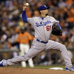 Los Angeles Dodgers starting pitcher Josh Beckett throws to the San Francisco Giants during the first inning of a baseball game Friday, Sept. 7, 2012, in San Francisco.