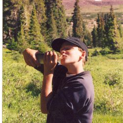 David Phillips giving his newly caught fish a kiss in Christmas Meadows, Utah.