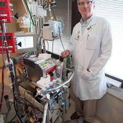 Dr. William Lynch, a cardiothoracic surgeon who directs the UI hospital's ECMO program, stands next to an Extracorporeal Membrane Oxygenation machine, or ECMO, as it treats a patient at University Hospitals Thursday, Aug. 23, 2012 in Iowa City, Iowa.  The UI hospital's strong and growing adult ECMO program draws patients from across the Midwest and sometimes from across the country.