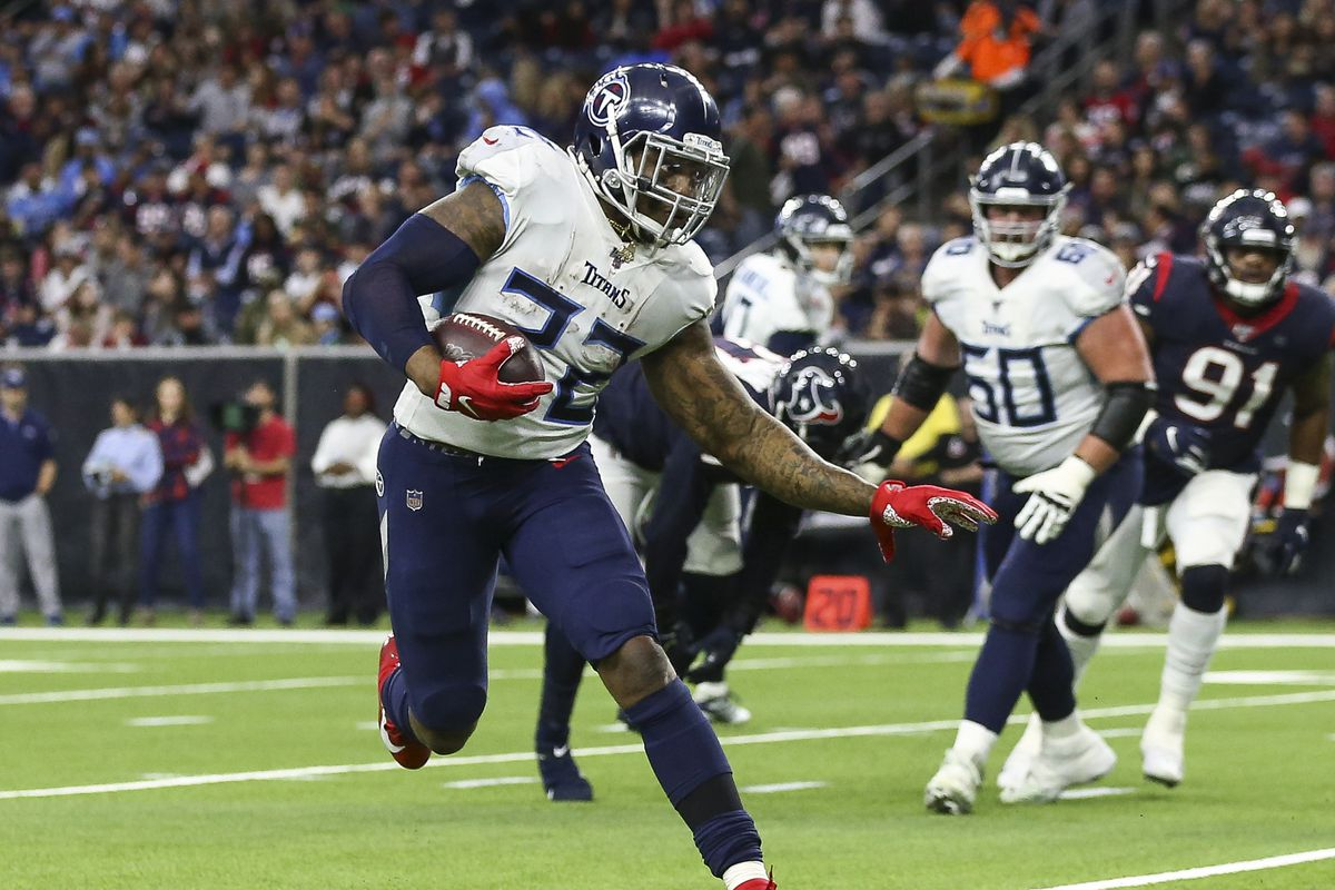Tennessee Titans running back Derrick Henry runs for a touchdown during the third quarter against the Houston Texans at NRG Stadium.