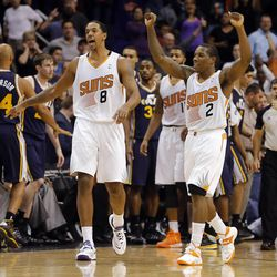 Phoenix Suns' Eric Bledsoe (2) celebrates with teammate Channing Frye (8) after sinking a three-point basket with 0.7 seconds to play against the Utah Jazz during the second half of an NBA basketball game on Friday, Nov. 1, 2013, in Phoenix. The Suns won 87-84.