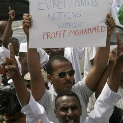 A Sudanese protester holds a placard during a protest in Khartoum, Sudan, Friday, Sept. 14, 2012, as part of widespread anger across the Muslim world about a film ridiculing Islam's Prophet Muhammad. Germany's Foreign Minister says the country's embassy in the Sudanese capital of Khartoum has been stormed by protesters and set partially on fire. Minister Guido Westerwelle told reporters that the demonstrators are apparently protesting against an anti-Islam film produced in the United States that denigrates the Prophet Muhammad.