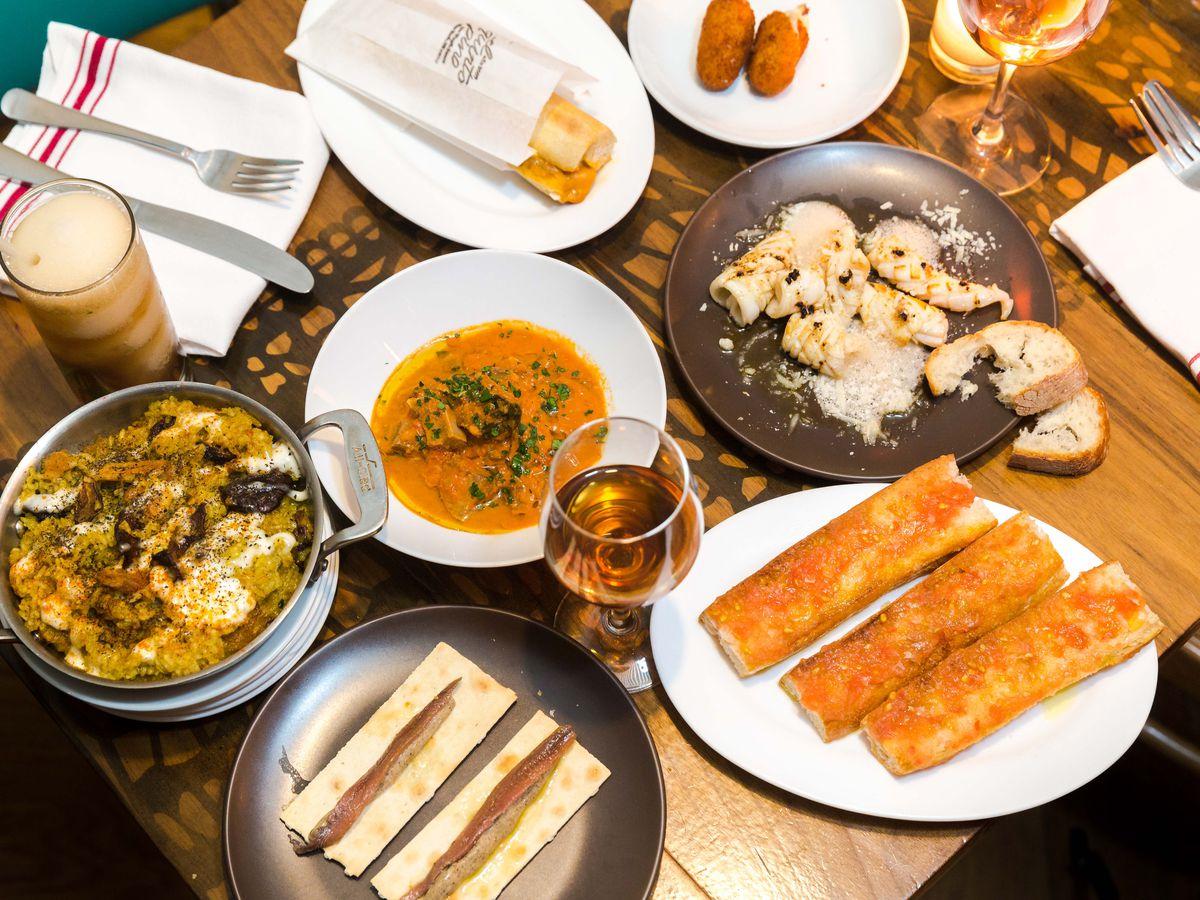 A spread of tapas on a restaurant table