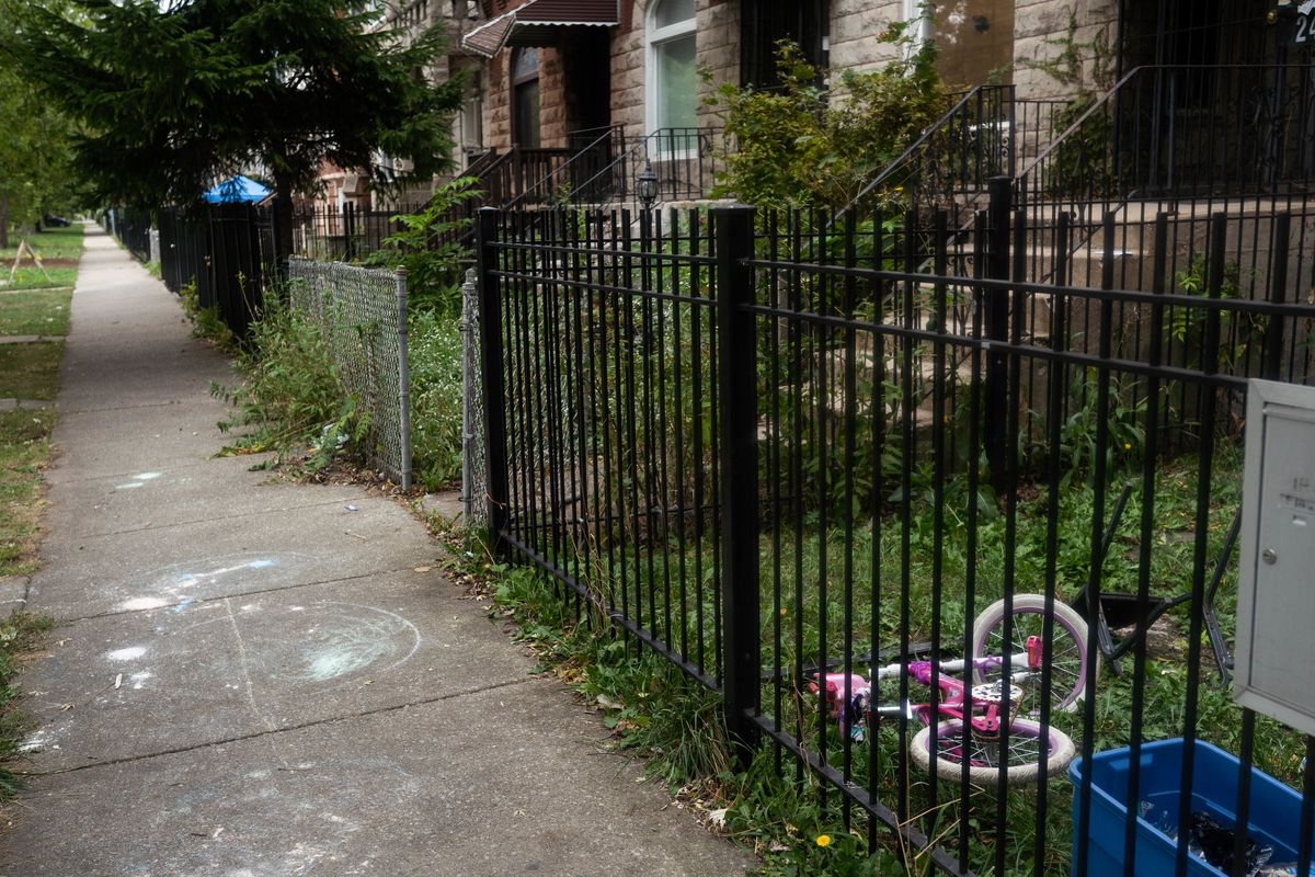 A bicycle lies in the front yard of a house in the 3200 block of West Fulton Boulevard, the same block where police said a 5-year-old girl was stabbed to death in East Garfield Park, Saturday, Sept. 26, 2020.