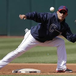 Cleveland Indians shortstop Asdrubal Cabrera reaches for a throw to second during workouts  in preparation for Thursday's opening day baseball game against the Toronto Blue Jays at Progressive Field in Cleveland on Wednesday, April 4, 2012.