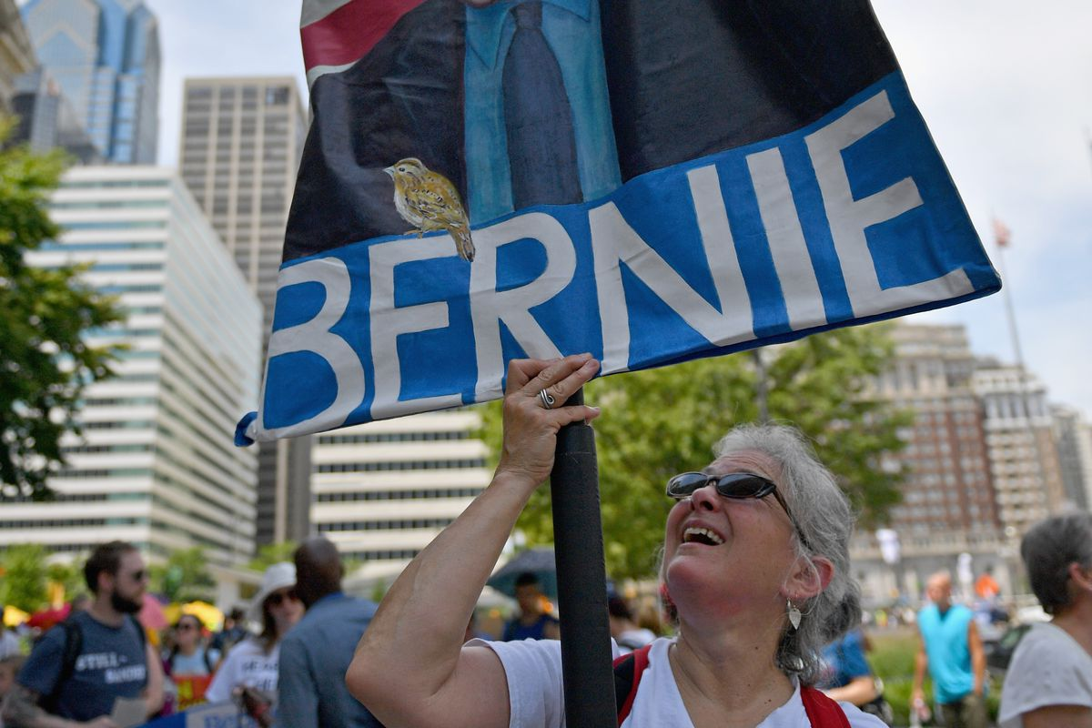 Activists and Bernie Sanders supporters march through downtown Philly before the beginning of the DNC convention.