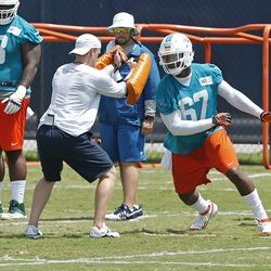 DAVIE, FL - MAY 23: Tevin Mims #67 of the Miami Dolphins participates in drills during the rookie minicamp on May 23, 2014 at the Miami Dolphins training facility in Davie, Florida.
