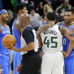 Utah Jazz guard Donovan Mitchell is greeted by Oklahoma City Thunder guard Russell Westbrook, right, forward Paul George and forward Carmelo Anthony following NBA basketball in Salt Lake City on Saturday, Dec. 23, 2017.