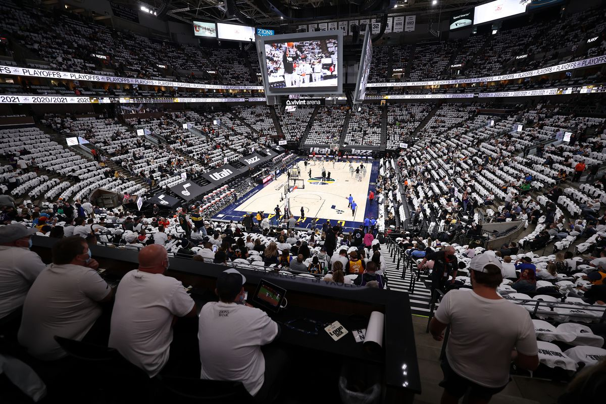 Fans watch warmups as the Utah Jazz and the Memphis Grizzlies play in game one of their NBA playoff series at Vivint Arena in Salt Lake City on Sunday, May 23, 2021.