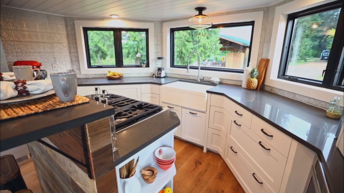 A white and gray kitchen in a tiny house.