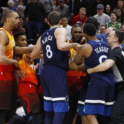 Minnesota Timberwolves' Jeff Teague (0) and Utah Jazz's Jae Crowder, back, tussle after Teague was called for a foul for pushing Utah Jazz's Ricky Rubio to the court during the second half of an NBA basketball game Friday, March 2, 2018, in Salt Lake City. Teague was called for a flagrant foul and ejected following the fight on the court. The Jazz won 116-108. (AP Photo/Kim Raff)