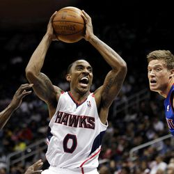 Atlanta Hawks point guard Jeff Teague (0) looks to shoot past Detroit Pistons' Will Bynum, left, and Jonas Jerebko, of Sweden, during the second quarter of an NBA basketball game, Friday, April 6, 2012, in Atlanta.