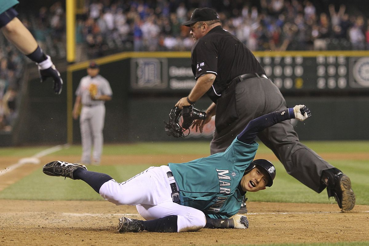 SEATTLE, WA - MAY 07:  Munenori Kawasaki #61 of the Seattle Mariners scores the winning run in a 3-2 defeat of the Detroit Tigers at Safeco Field on May 7, 2012 in Seattle, Washington. (Photo by Otto Greule Jr/Getty Images)