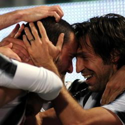 Juventus defender Leonardo Bonucci, center, celebrates with teammate Andrea Pirlo, right, who offered the assist for his goal during the Serie A soccer match between Palermo and Juventus, in Palermo, Italy, Saturday, April 7,  2012.