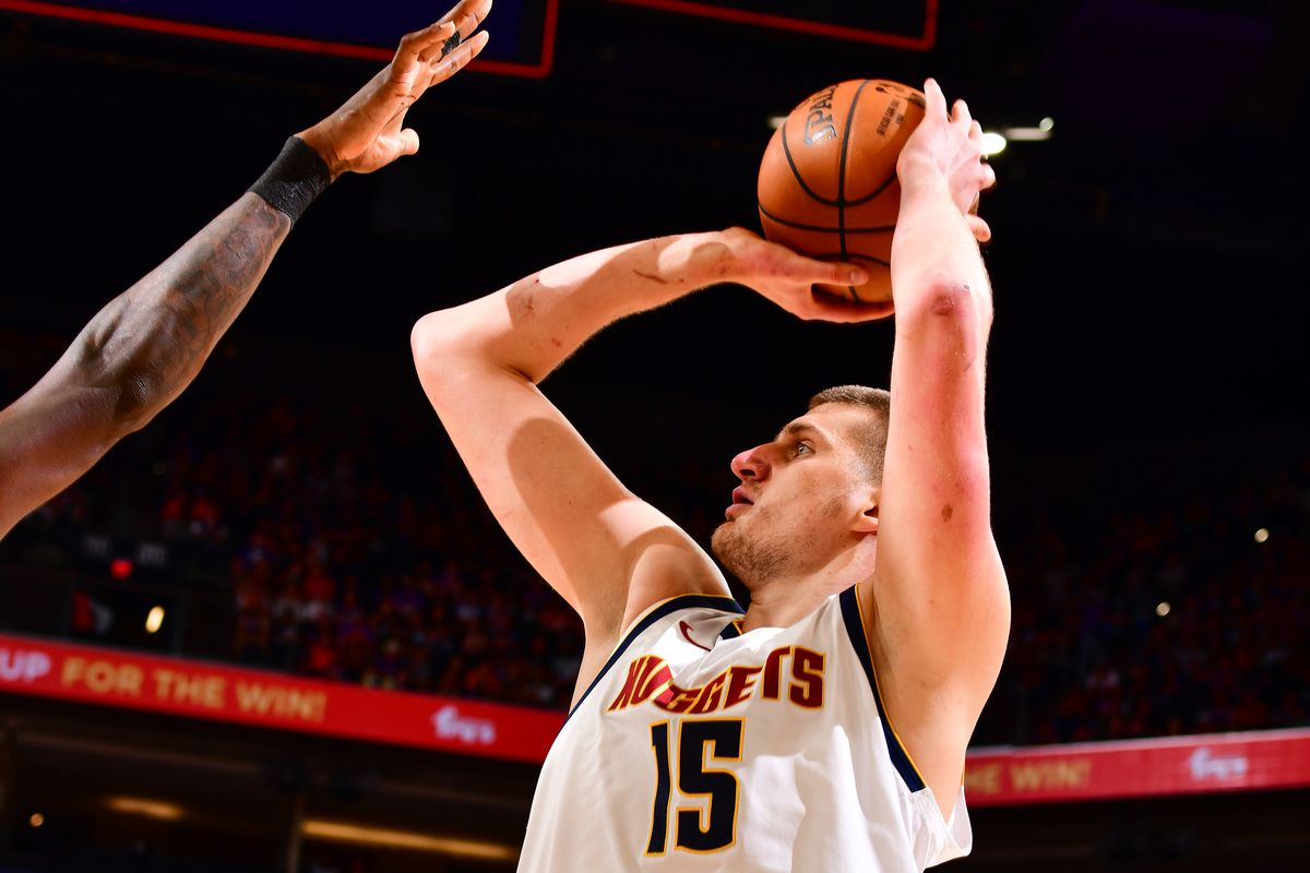 Nikola Jokic of the Denver Nuggets shoots a three point basket against the Phoenix Suns during Round 2, Game 1 of the 2021 NBA Playoffs on June 7, 2021 at Phoenix Suns Arena in Phoenix, Arizona.