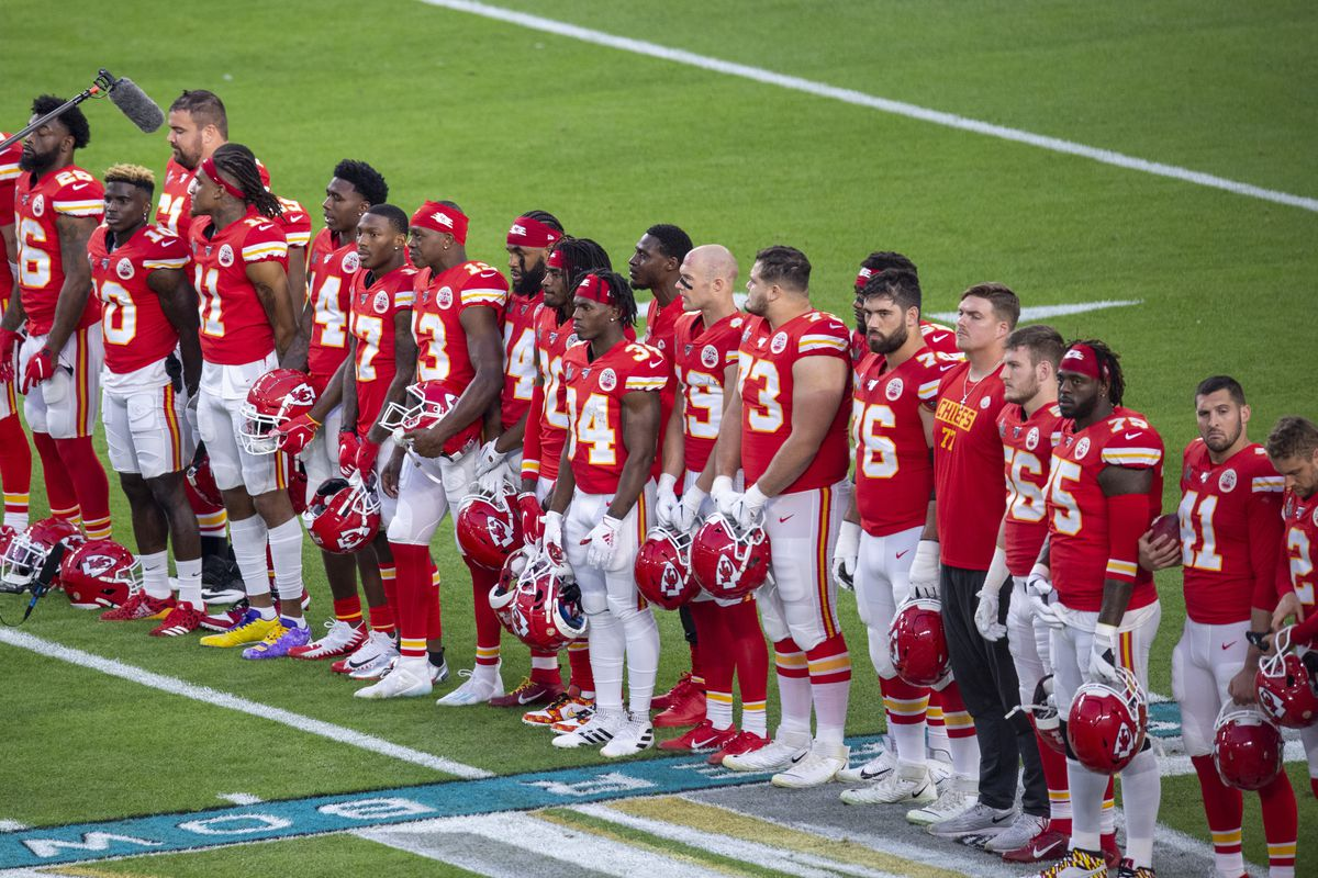 Kansas City players line up on the field before the NFL Super Bowl LIV game between the Kansas City Chiefs and the San Francisco 49ers at the Hard Rock Stadium in Miami Gardens, FL on February 2, 2020.