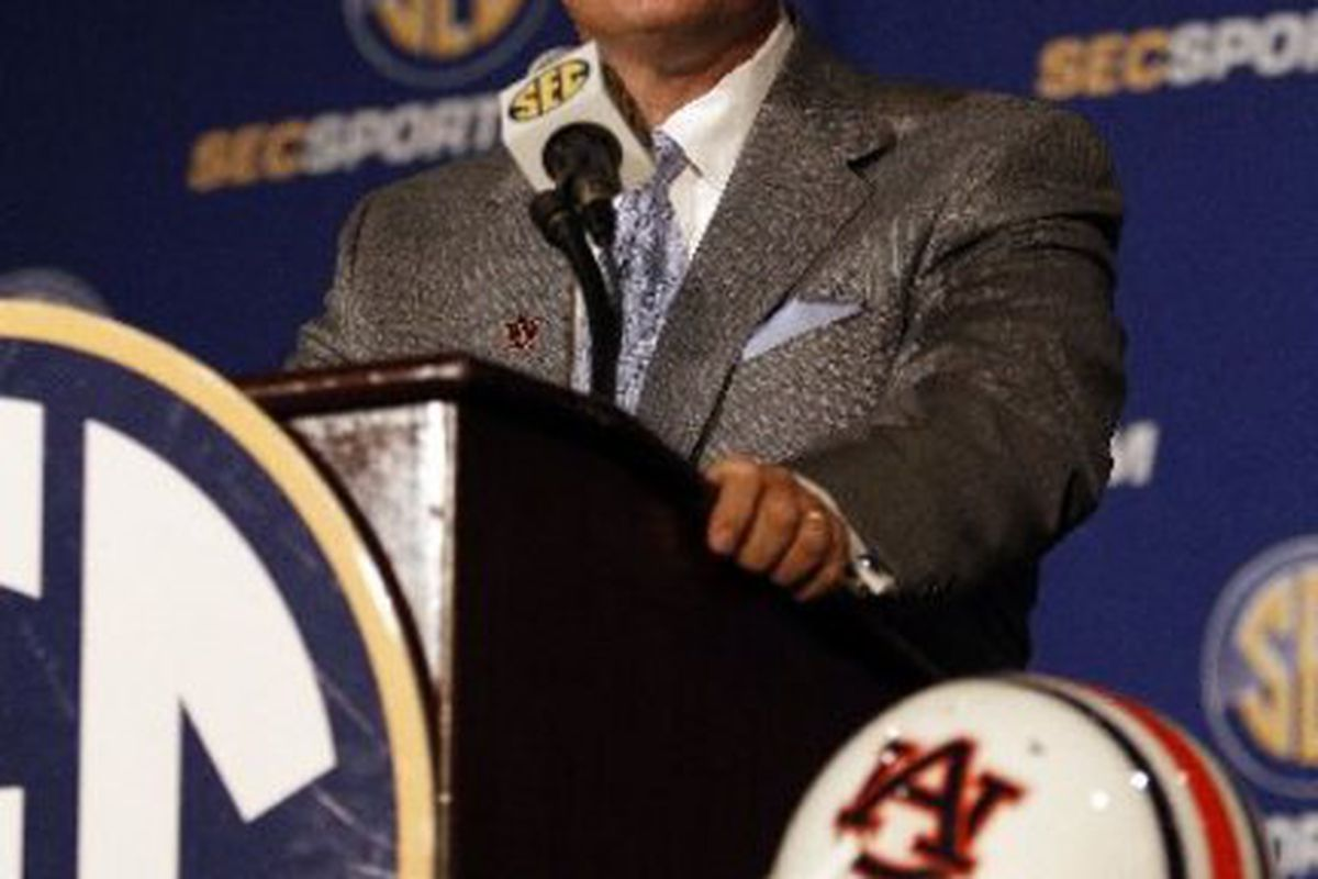 Auburn Head Coach Gene Chizik takes questions from the media at the 2010 SEC Media Days in Hoover, Alabama.
