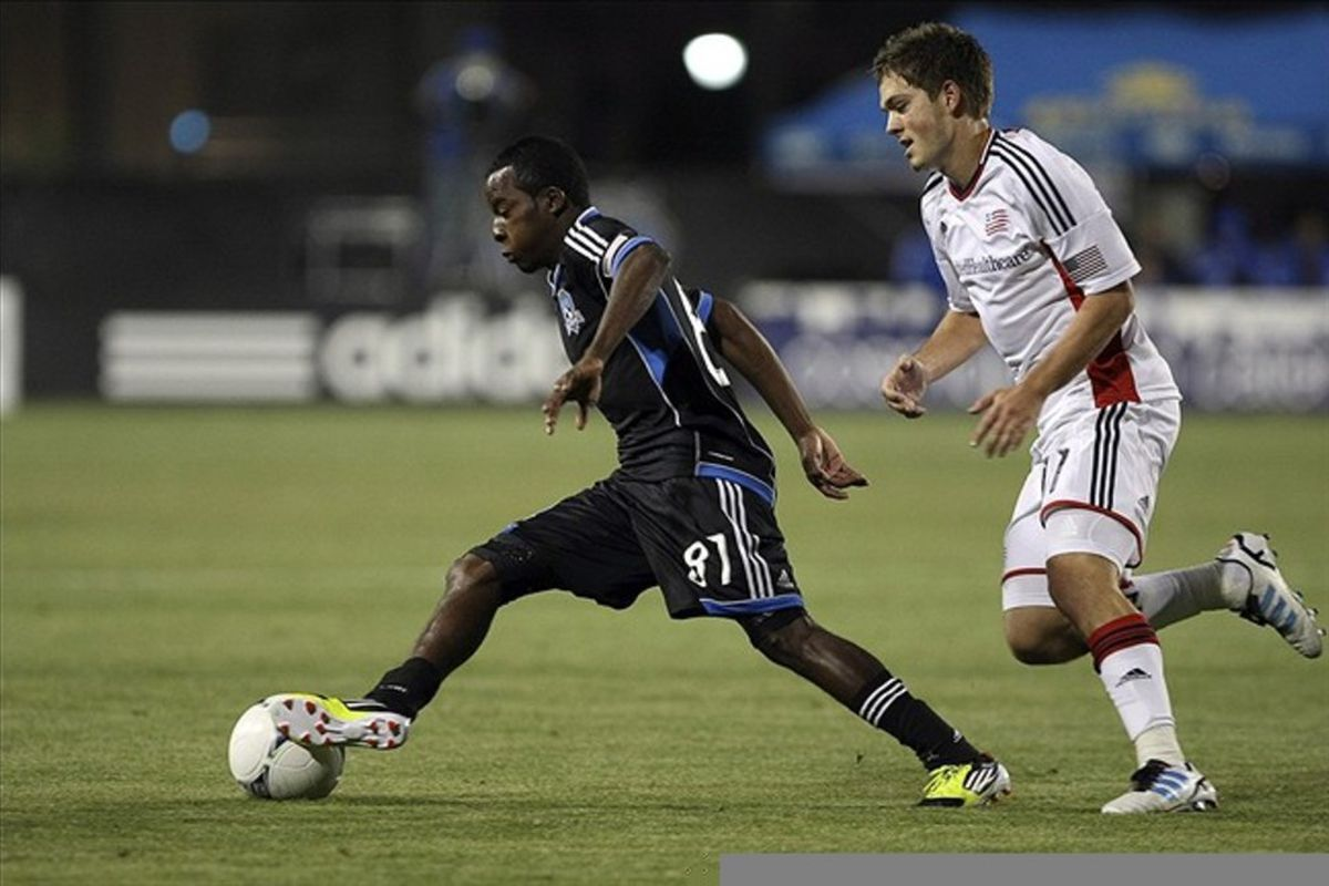 March 10, 2012; Santa Clara, CA, USA; San Jose Earthquakes midfielder Marvin Chavez (81) steals the ball from New England Revolution midfielder Kelyn Rowe (11) during the first half at Buck Shaw Stadium. Mandatory Credit: Kelley L Cox-US PRESSWIRE