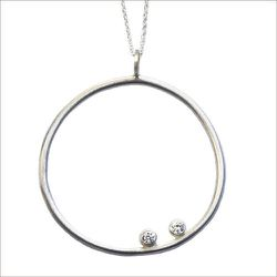 "Daphne Olive hoop pendant, <a href=""http://tabletopdc.com/silver/hoop-pendant"">$88</a> at Tabletop"