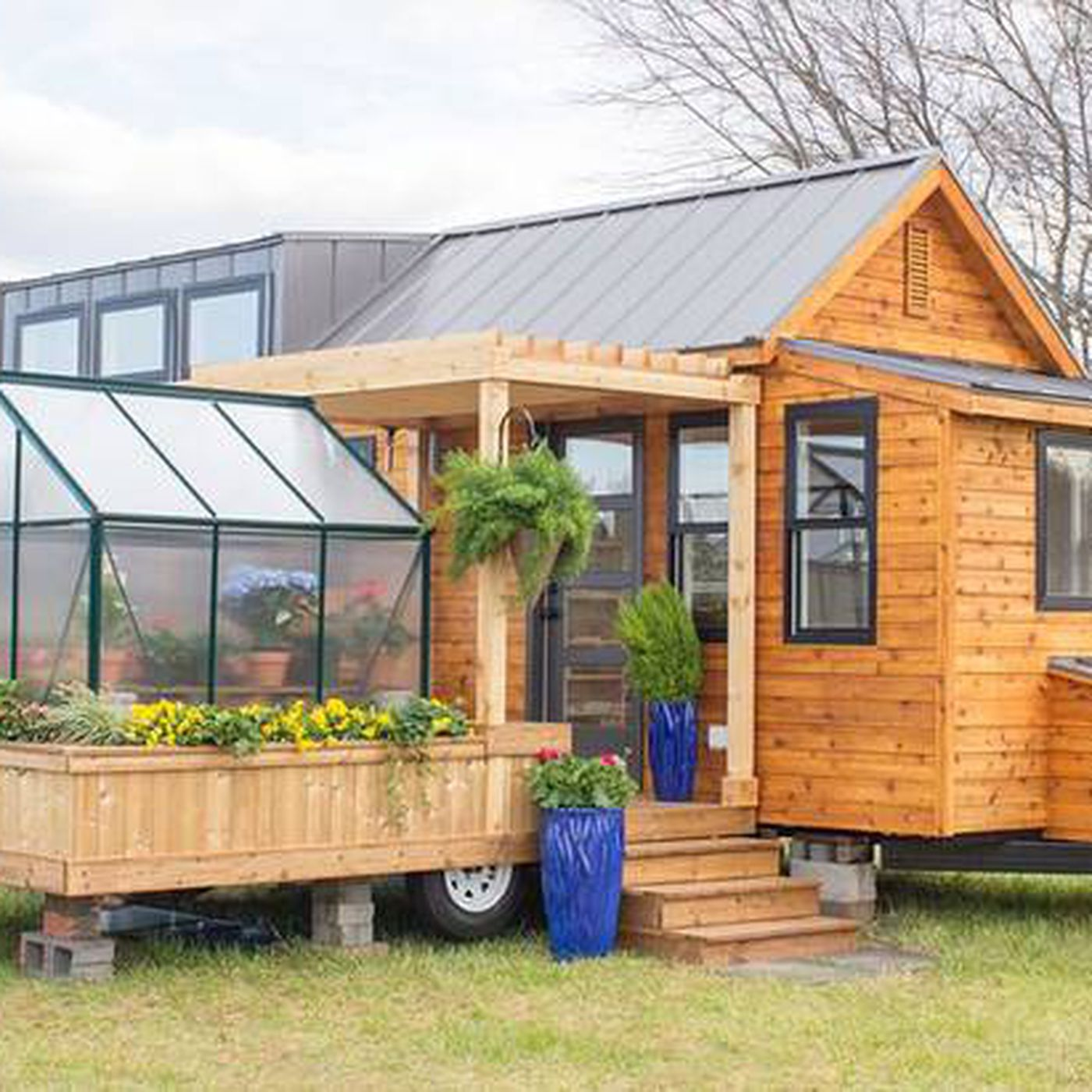 Tiny house comes with a greenhouse and porch - Curbed