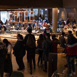 Customers waited in long lines on opening day at the Starbucks Reserve Roastery in Chicago.