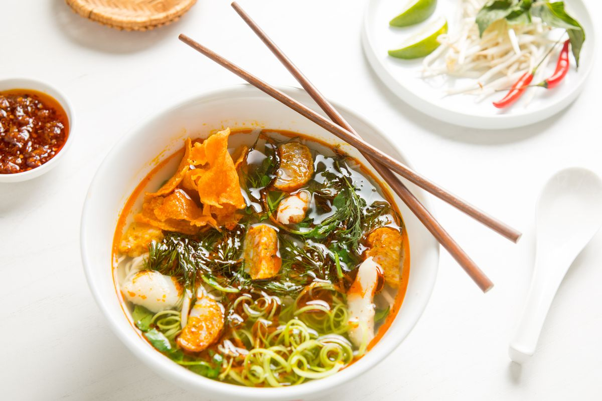 Bún Cá (Fish noodle soup with fish and chicken broth, dill, turmeric fish ball, fish cracker, poached fish, water spinach stems, and thin vermicelli noodle)
