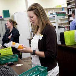 Nikki Hendriksen works in the pharmacy at Smith's Marketplace in West Jordan on Thursday, Aug. 10, 2017.