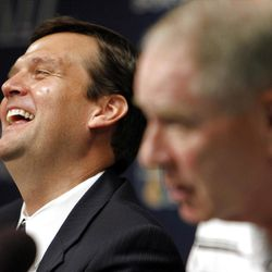 Dennis Lindsey, left, introduced as the General Manager of the Utah Jazz, laughs as Kevin O'Connor, Executive Vice President of Basketball Operations for the Utah Jazz answers questions at the Zions Bank Basketball Center in Salt Lake City, Tuesday, Aug. 7, 2012.