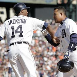 Detroit Tigers' Miguel Cabrera, right, is congratulated by Austin Jackson (14) after hitting a two-run home run to score the pair in the first inning of a baseball game against the Boston Red Sox Saturday, April 7, 2012, in Detroit.