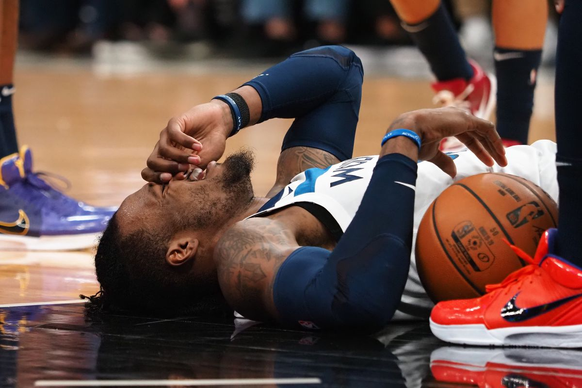 Minnesota Timberwolves forward Robert Covington holds his nose after being fouled by the Sacramento Kings during the second quarter at Golden 1 Center.