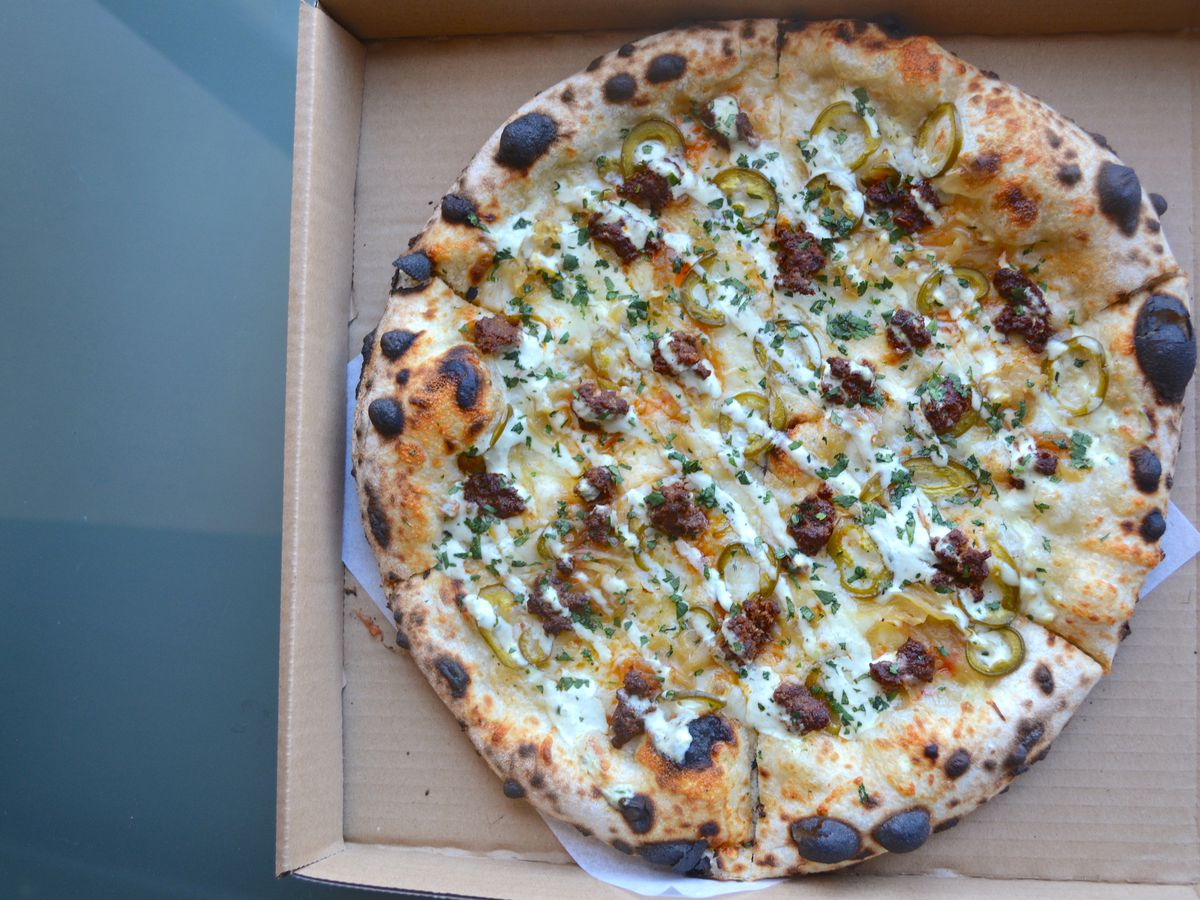 Pizza with bison chorizo, cheddar, onions, jalapeños, and green-chile ranch
