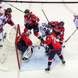 A Puck Between Holtby and St. Louis