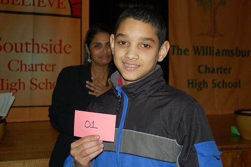 Steven Taveras holds up a card indicating that he was the first student selected for Believe Southside Charter High School.