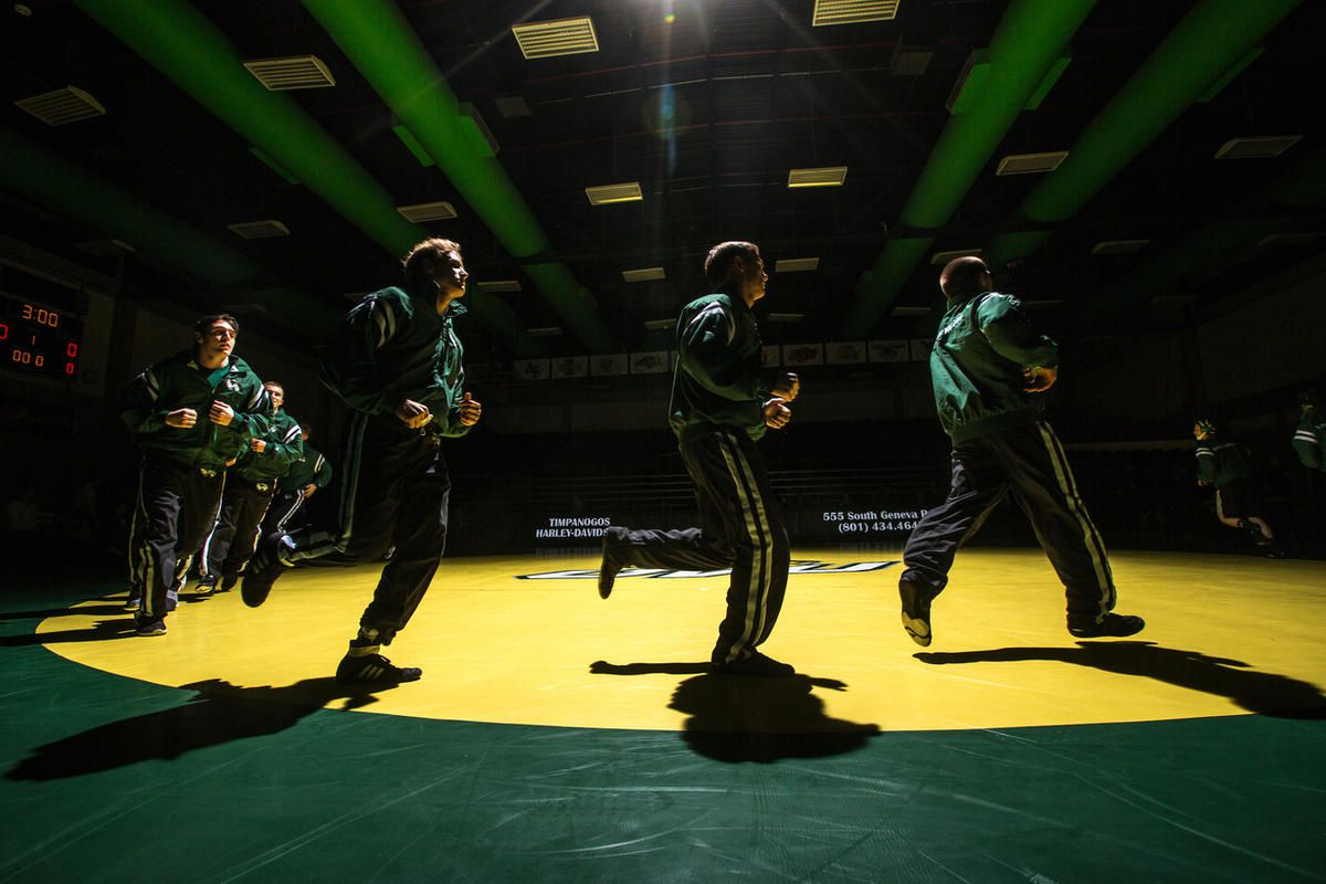 The Utah Valley wrestling teams warms up around the mat prior to its 17-16 victory over No. 23 Oregon State on Dec. 15, 2016. The Utah Valley Regional Training Center was recently approved by USA Wrestling to be an Olympic Regional Training Center for wre