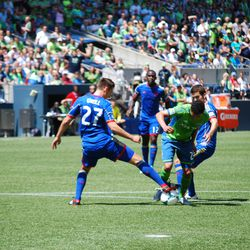 Hoping to penetrate into the box, Lamar Neagle receives a greeting from one Rapids defender after another, starting here with Shane O'Neill.
