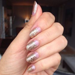 In order to have glittery, reflective nails for the shoot, I get <strong>Julie Ventura</strong>, one of our incredibly talented manicurists, to paint my nails in our <strong>Bling Ring</strong> look. She blends a custom gold for my nails to make them espe