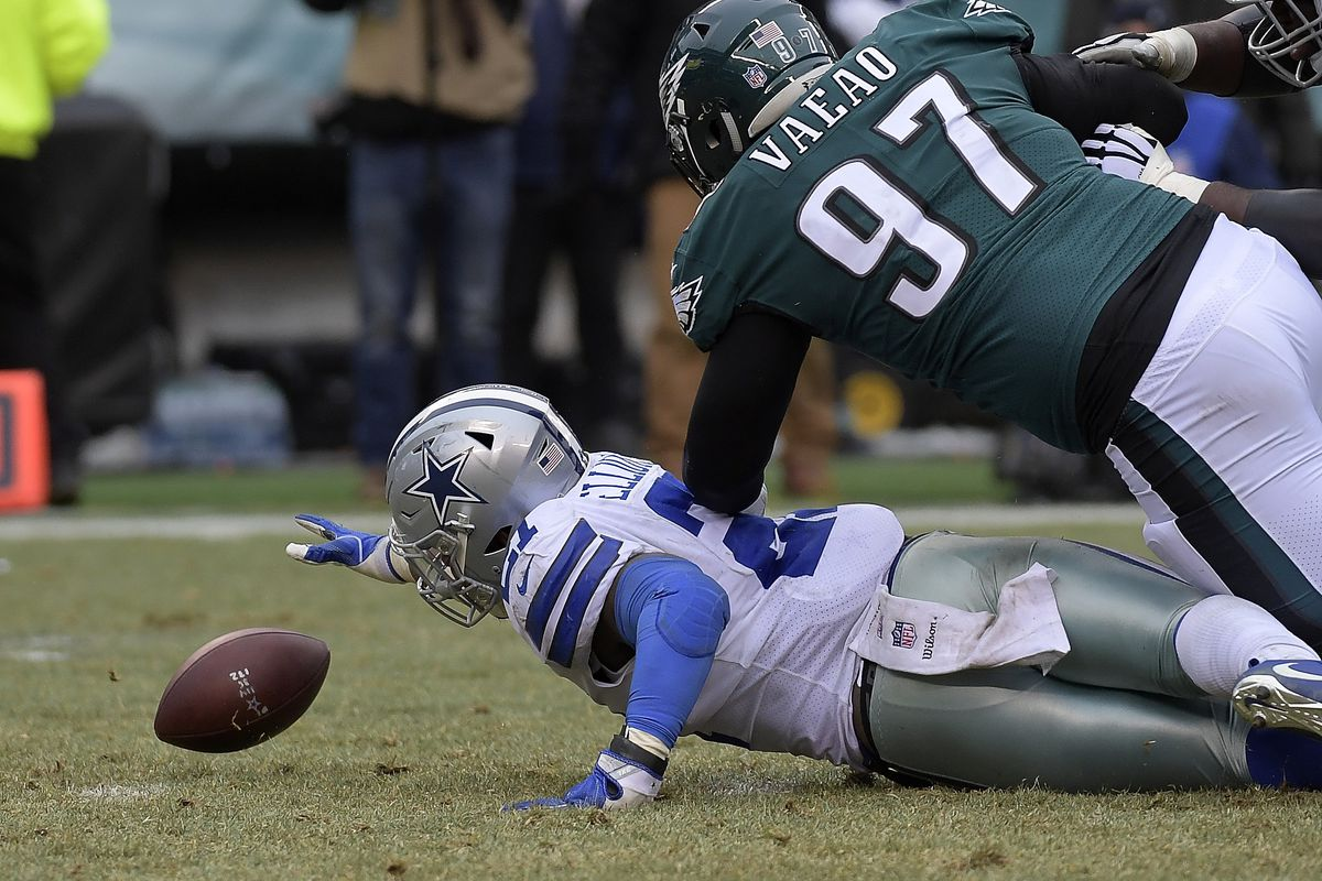 Dallas Cowboys running back Ezekiel Elliott fumbles the ball during the second quarter as Philadelphia Eagles defensive tackle Destiny Vaeao defends at Lincoln Financial Field in Philadelphia on Sunday, Dec. 31, 2017. The Cowboys won, 6-0.
