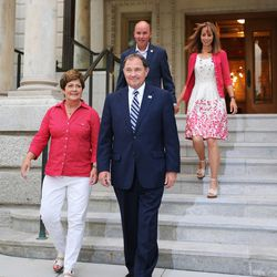 Gov. Gary Herbert, right, and his wife, Jeanette, left, and Lt. Gov. Spencer Cox, back left, and his wife, Abby, exit the Governors Mansion in Salt Lake City on Tuesday, June 28, 2016. Herbert defeated Jonathan Johnson in Tuesday's primary.